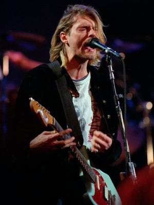 Kurt Cobain, lead singer of Nirvana, performs during the taping of MTV's Live and Loud Production in Seattle in 1993.
