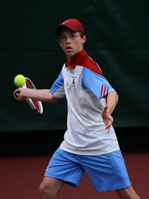 Arrowhead's Noah Ebel returns a volley at the state tournament June 1.