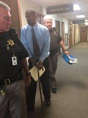 Robert Glene Card Jr. leaves the courtroom Friday after