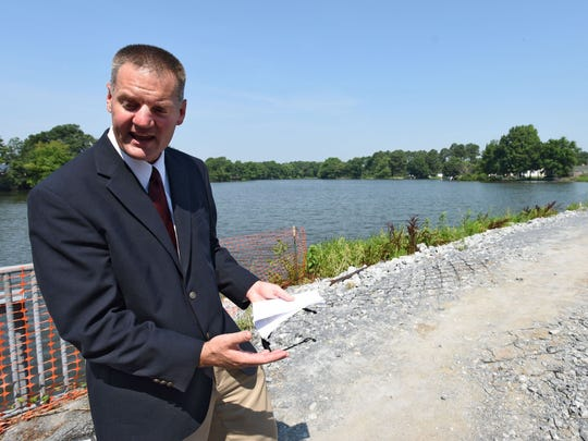 Berry Benton, a senior bridge engineer with the Delaware Department of Transportation, talks Monday about what his team is going to do at Hearns Pond Dam, which was damaged several times in the past 20 years and will be restored as part of a new program to prevent dam failures in the future.