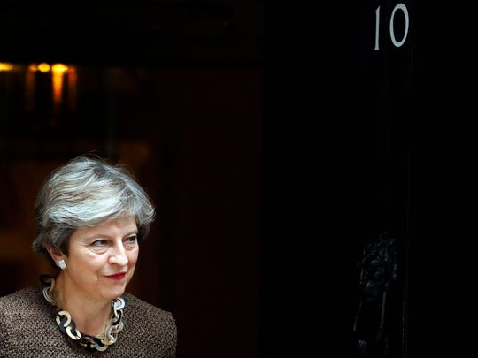 British Prime Minister Theresa May walks out at 10