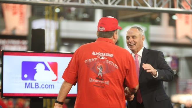 MLB Commissioner Rob Manfred is greeted by Reds great Johnny Bench during a Q&A at FanFest.