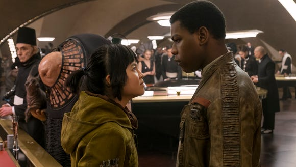 Rose (Kelly Marie Tran) keeps Finn (John Boyega) in