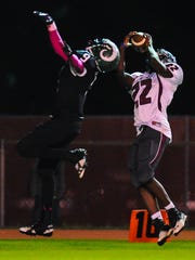 Parkside free safety Juwan Williams attempts to deflect a pass as Snow Hill wide reciever Ameer Fisher pulls it in at County Stadium on Thursday evening.