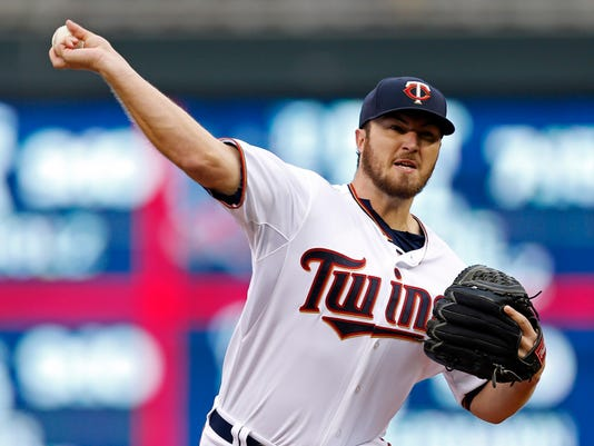 Minnesota Twins pitcher Phil Hughes throws against the Tampa Bay Rays in the first inning of a baseball game, Friday, May 15, 2015, in Minneapolis. (AP Photo/Jim Mone)