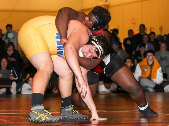 Bound Brook's Jervey Sistrunk, top, wrestles Manville's Michael Tyle at heavyweight in the Region 5 wrestling finals at Hunterdon Central High School in Flemington on February 24, 2018. (Photo by Keith Muccilli, Correspondent)