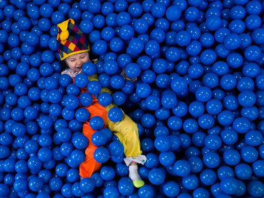Graciela Petracco, 3, plays in a ball pit at the grand reopening of Paws Discovery Farm Wednesday, March 1 in Mount Laurel.