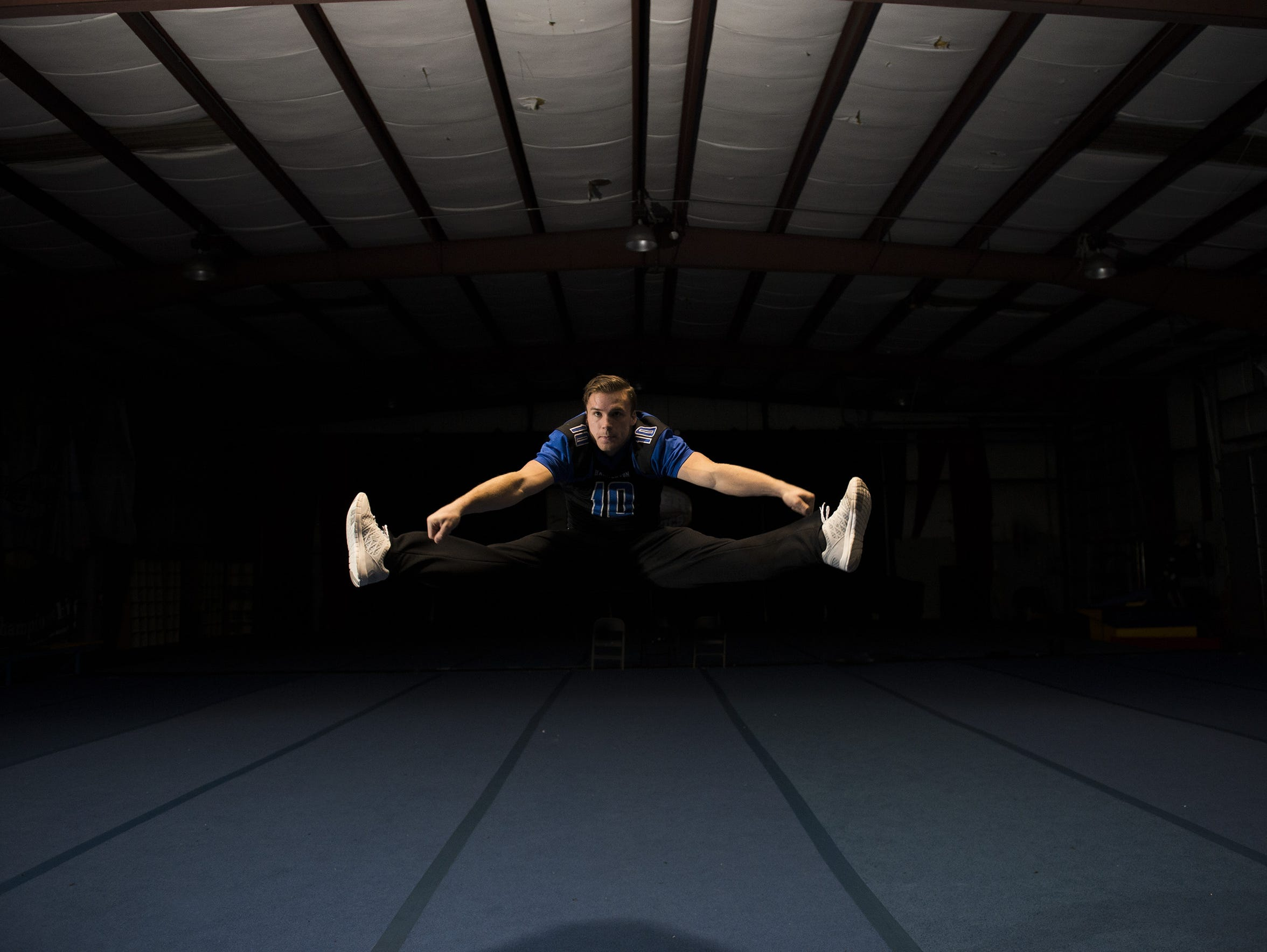 Hammonton senior Sean Ryker, 18, performs a toe-touch