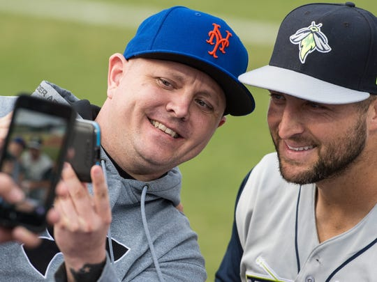 Columbia Fireflies outfielder Tim Tebow poses for a selfie with a fan during a game against the Delmarva Shorebirds at Arthur W. Perdue Stadium on Wednesday, May 10, 2017.
