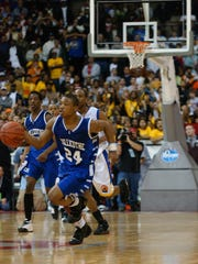 Chillicothe's Anthony Hitchens drives down the court in the final 5 seconds of overtime before passing the ball to Ray Chambers for the winning basket at the 2008 Division II State Championship at Ohio State University's Schottenstein Center.