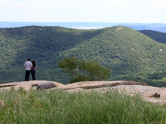 A couple take in the views from Perkins Tower at Bear Mountain State Park. (Carucha L. Meuse/The Journal News )