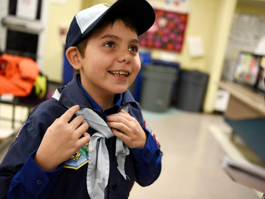 Joe Maldonado, the first openly transgender member of the Boy Scouts of America, proudly shows off the uniform he received from Kyle Hackler, leader of Cub Scouts Pack 20 of Maplewood/South Orange, NJ,  at his first meeting with his new pack.