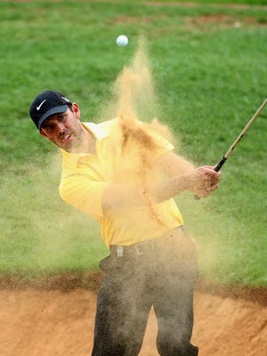 Charl Schwartzel moved into a tie with Marco Crespi at the South African Open on Friday.