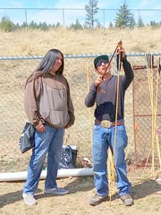 High school students learned how to use the atlatl to throw a spear. The tool uses leverage to achieve velocity.