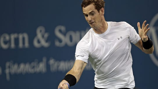 Andy Murray returns a shot during the first set Wednesday