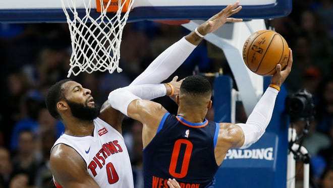 Pistons center Andre Drummond (0) defends as Thunder guard Russell Westbrook (0) shoots in the second quarter of the Pistons' 99-98 win on Friday, Nov. 24, 2017, in Oklahoma City.