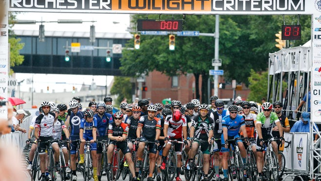 The start of the 2016 Rochester Twilight Criterium with participation from amateurs and professionals on a one mile loop in downtown Rochester.