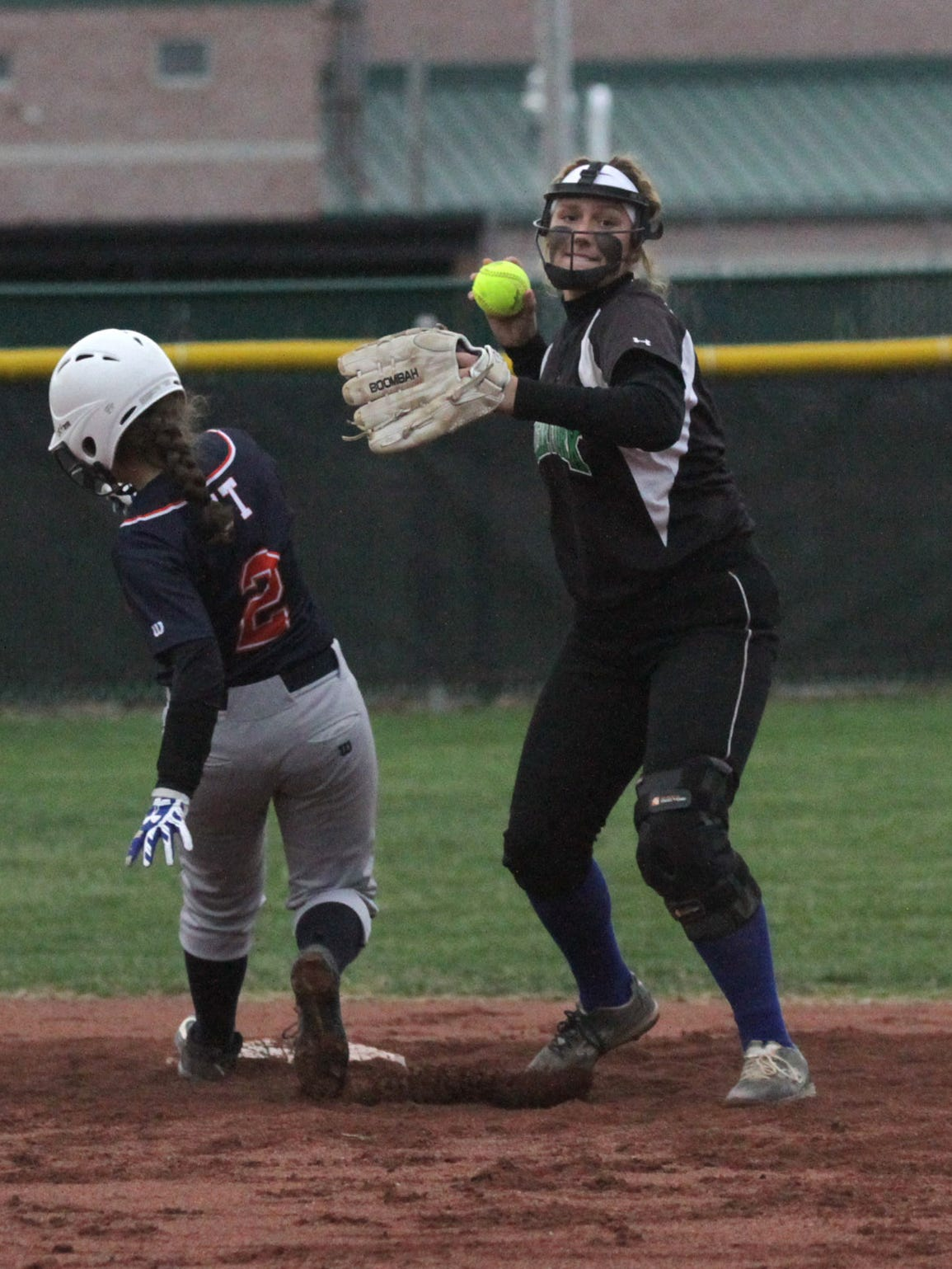 Clear Fork's Haylie Miller throws into the in field