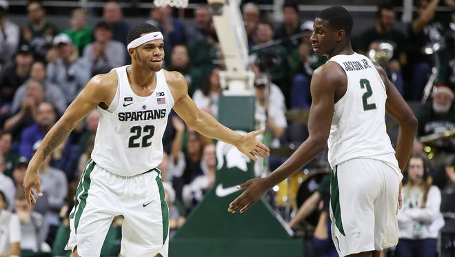 Miles Bridges (22) of the Michigan State Spartans celebrates a second-half play with Jaren Jackson Jr. while playing Houston Baptist at the Jack T. Breslin Student Events Center on December 18, 2017 in East Lansing, Michigan. Michigan State won the game 107-62.