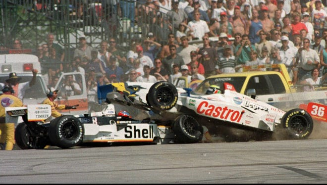 Alex Barron (36) crashes into Brian Herta on turn five during the Texaco-Havoline 200 Sunday, Aug. 16, 1998, in Elkhart Lake, Wis. (AP Photo/Andy Manis)