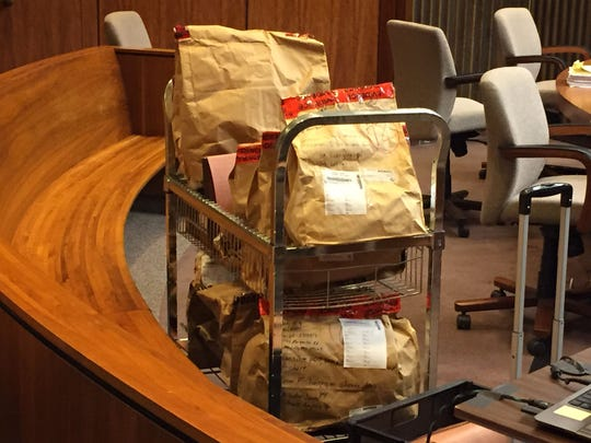 Bags of evidence in Macomb County Circuit Court on Jan. 20, 2016,for the start of the trial for James VanCallis of Wales Township, who is charged in the slaying of Armada teen April Millsap along the Macomb Orchard Trail.