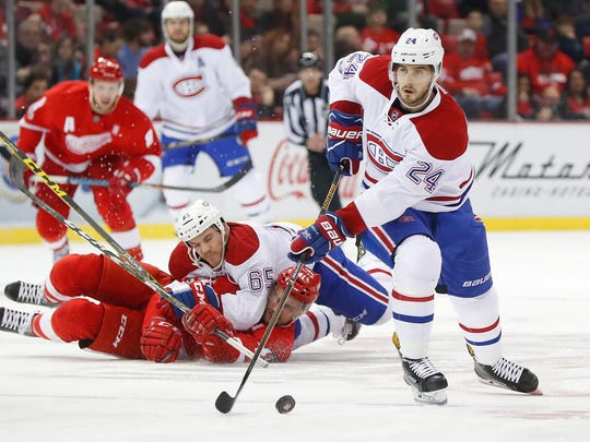 Montreal Canadiens left wing Phillip Danault (24) carries the puck against the Detroit Red Wings in the first period of an NHL hockey game Monday, Jan. 16, 2017, in Detroit. A federal lawsuit filed by the Caledonian Record of St. Johnsbury accuses the Newport Daily Express of improperly downloading and publishing an Associated Press photograph from this event.