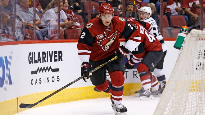 Arizona Coyotes' Luke Schenn (2) skates with the puck against the Los Angeles Kings during the first period of a preseason NHL hockey game Monday, Sept. 26, 2016, in Glendale, Ariz.  The Coyotes defeated the Kings 5-3.