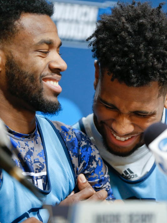 Rhode Island's Jarvis Garrett, left, and E.C.Matthews share a laugh as they take questions during a news conference for an NCAA college basketball first round game in Pittsburgh, Wednesday, March 14, 2018. (AP Photo/Keith Srakocic)