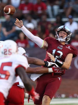 Troy quarterback Brandon Silvers, shown in the season opener against Austin Peay, set career highs for completions and passing yards in Saturday's win at Idaho.