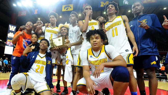 Woodbury celebrates after defeating Cresskill 60-58 in the Group 1 boys basketball state final at Rutgers University in Piscataway on Sunday. 03.11.18.