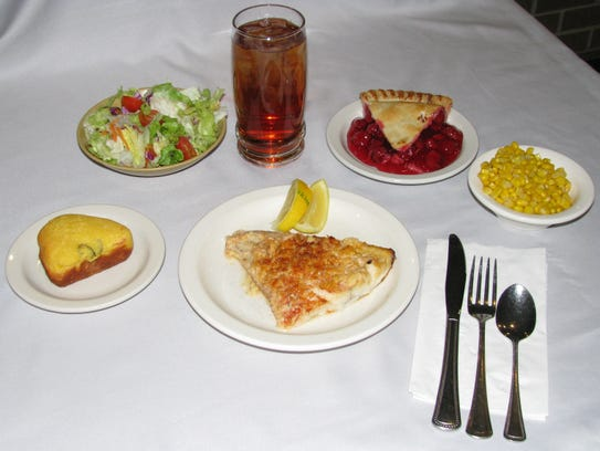 This 2012 photo shows a meal from Heritage Cafeteria prepared from scratch: baked white fish, buttered corn, tossed salad, jalapeño corn bread, cherry pie, and iced tea ($10).