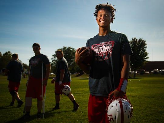 Creston High School quarterback Kylan Smallwood stands