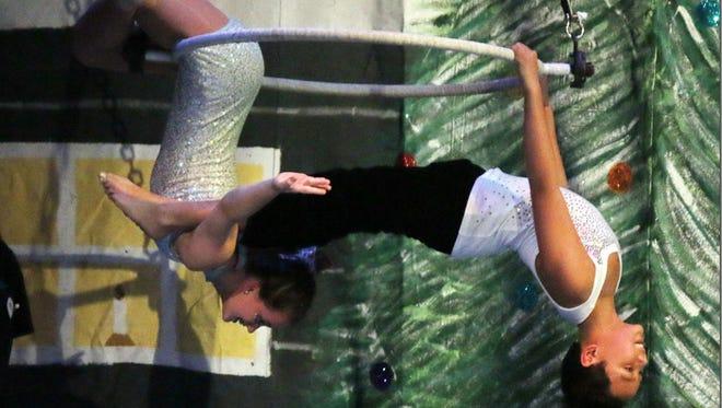 "Micah Nalzaro and Taryn Sovine performing on the spinning hoop during ""Santa Who?""."