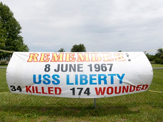 Bryce Lockwood placed signs on his fence facing I-44