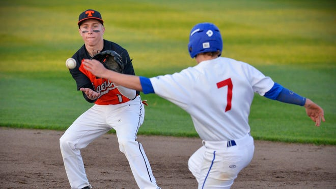 St. Cloud Tech shortstop Max Unze makes the catch to put out St. Cloud Apollo's Tanner Breidenbach (7) in the second inning Friday night, April 22 at Dick Putz Field.
