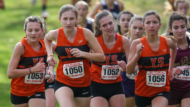 York Suburban runners climb a hill while competing in the girls 2A PIAA District 3 Cross Country Championships held Saturday at Big Spring High School in Newville, PA.