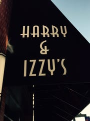 The ampersand in the Harry & Izzy's logo could be a turtle doing a headstand.