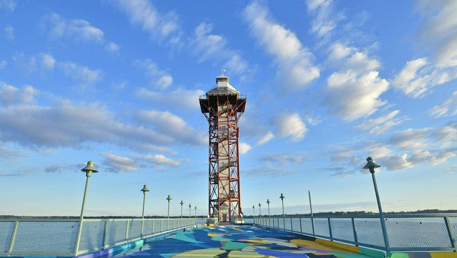 """The Bicentennial Tower, Aug. 18, at Dobbins Landing on Erie's bayfront is one of highlights of the Hagen History Center's Homeport Erie Driving Tour featuring 16bayfront historic sites. The artwork on in the foreground on the south side of the tower platform is titled """"Flotsam,"""" and was painted in August 2019 by internationally-known artist Rafael Gerlach, known as SatOne."""