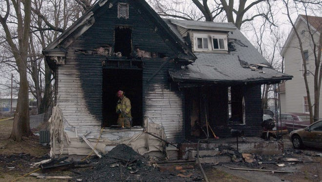 This house fire in the 1700 block of West Olive Street on March 15, 2010, left three children dead.