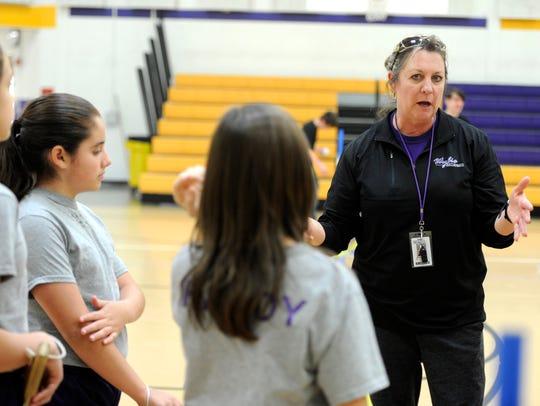 Physical education teacher Rose Bristow (right) splits