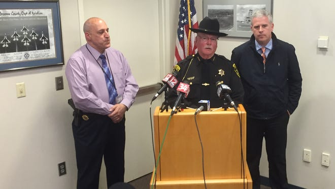 From left, Broome Security Director James Dadamio, Sheriff David Harder and County Executive Jason Garnar speak about a bomb threat to the Greater Binghamton Airport on Monday, March 27, 2017.