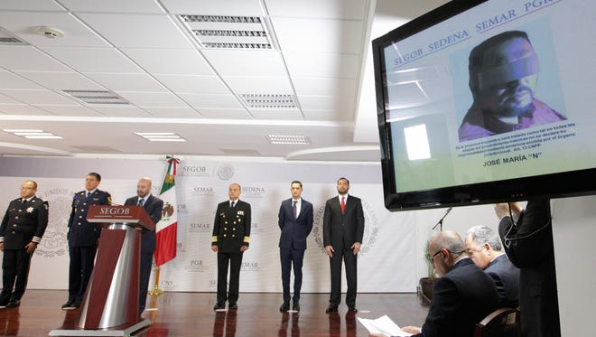 A screen shows a picture of Jose Maria Guizar Valencia, alias 'El Z43' and leader of Los Zetas drug cartel, as the head of the National Security Commission (CNS) Renato Salas (3-L) gives a press conference in Mexico City, Mexico, Feb. 9, 2018.