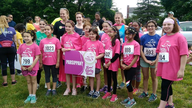 Parsippany Girls on the Run team gather for a pep talk and stretching before taking part in the 5K run.