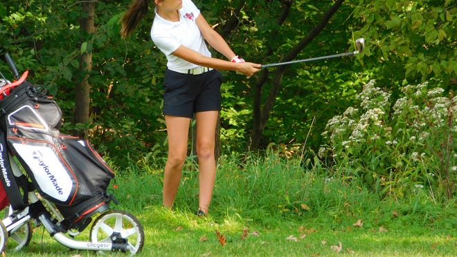 Pekin's Lauren Minkel gets out of trouble Saturday during the Lady Dragon Classic.