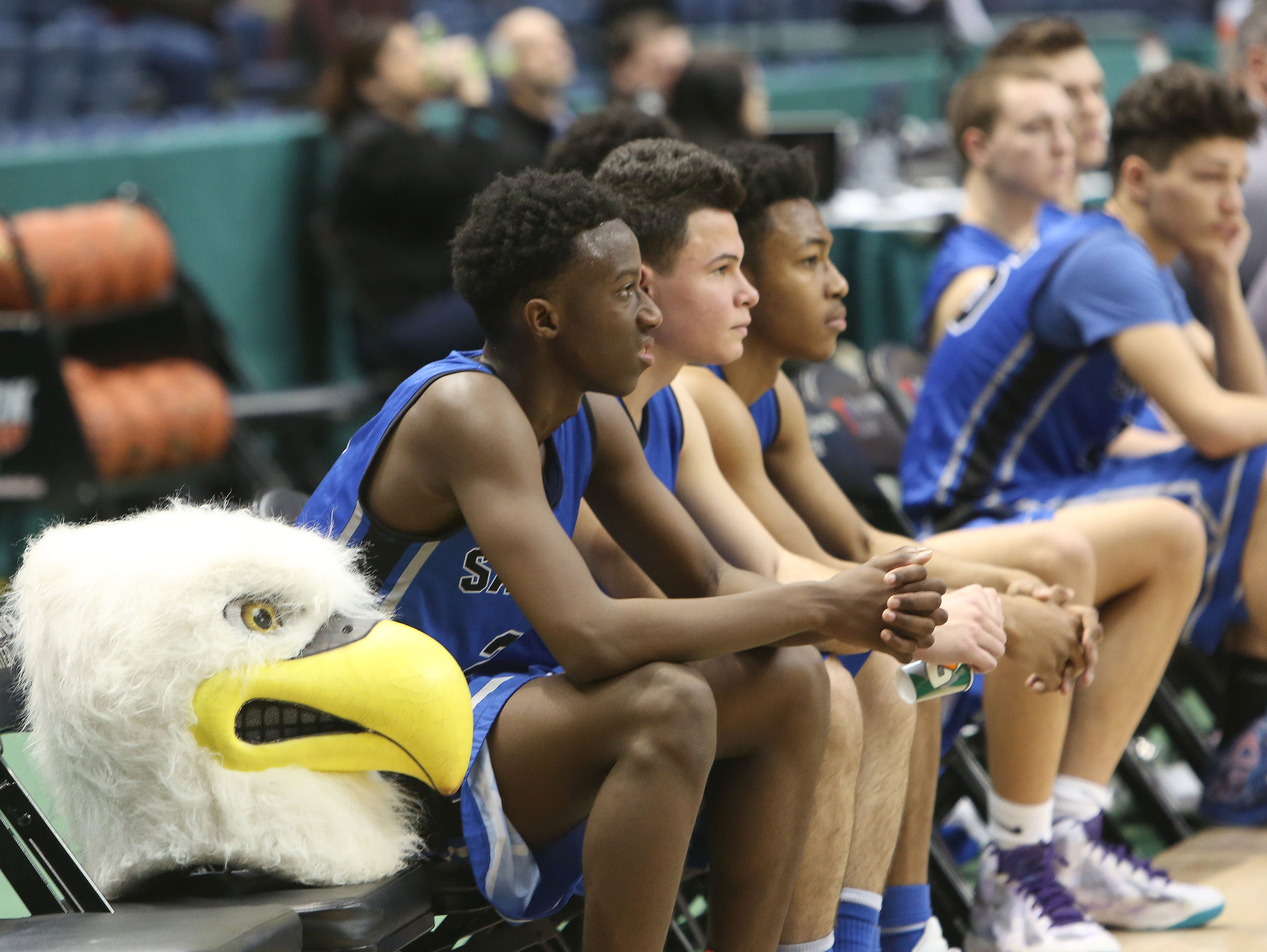 From left, Salesian's Anthony Mitchell, Xavier Tellez and Alex Roman, watch as the Eagles season comes to an end with a 63-45 loss to Collegiate in the Class B semifinal in the New York State Federation Tournament of Champions at the Times Union Center in Albany March 18, 2016.