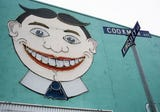 You may not know its name, but if you've been to Asbury Park you know the face.  This is the story behind the grinning mural known as Tillie.