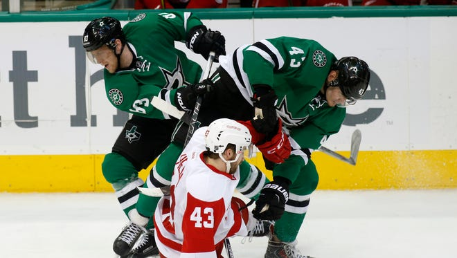 Detroit Red Wings center Darren Helm, center, collides with Dallas Stars wingers Ales Hemsky and Valeri Nichushkin, right, on Feb. 29, 2016, in Dallas.
