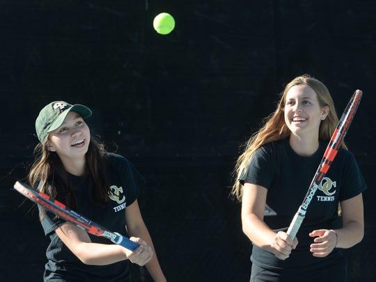 Oaks Christian's Emily Ackerman, left, and Chloe Bendetti