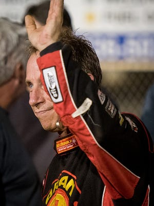 Stevie Smith acknowledges fans after winning the 25-lap 410 Sprints Feature Race on the opening night of Pennsylvania Speedweek at Williams Grove Speedway in Mechanicsburg on Friday, June 26, 2015.