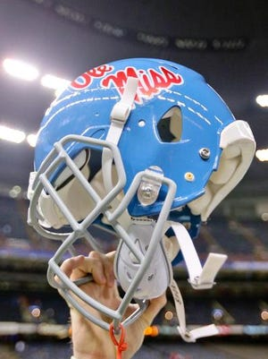 In this Jan 1 file photo, an Ole Miss player holds up his helmet celebrating a win against Oklahoma State in the 2016 Sugar Bowl at the Mercedes-Benz Superdome in New Orleans.